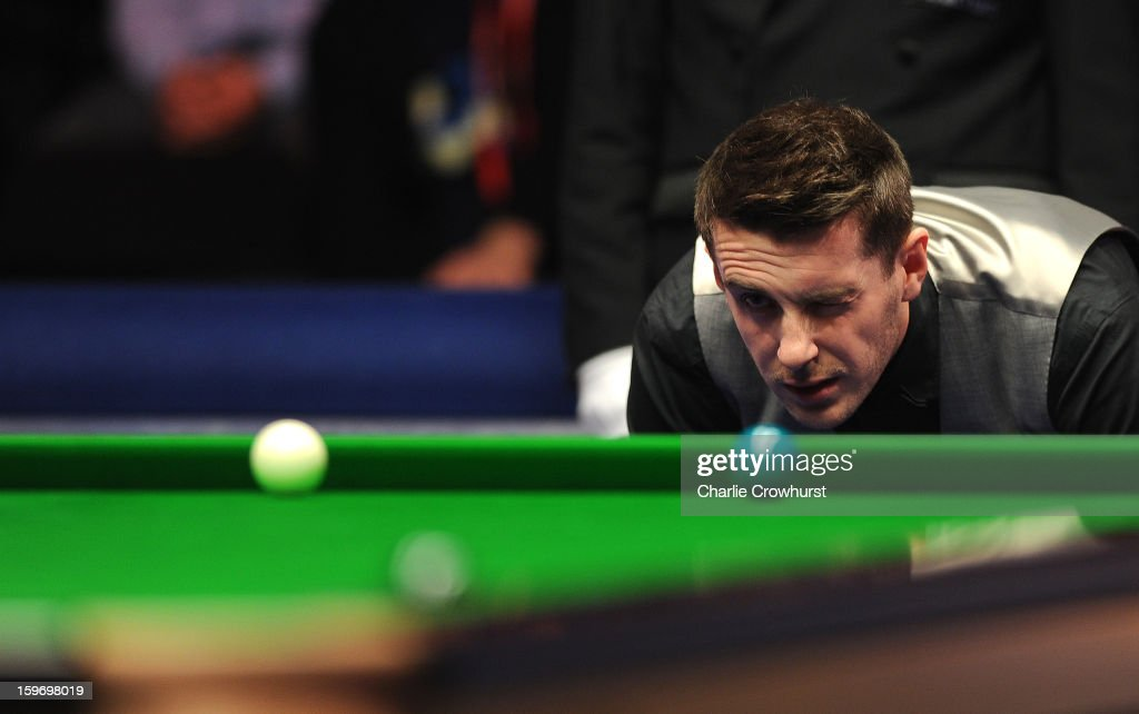 Mark Selby of England casts an eye of the balls during his quarter-final match against Mark Williams of Wales at Alexandra Palace on January 18, 2013 in London England.