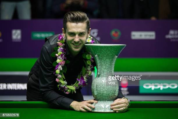 Mark Selby of England celebrates after winning the final match against Mark Allen of Northern Ireland on Day eight of the 2017 Snooker International...