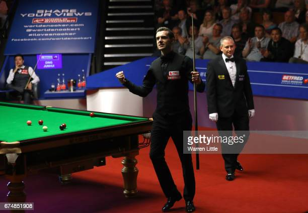 Mark Selby of England celebrates winning his semifinal match against Ding Junhui of China on day fifteen of Betfred World Championship 2017 at...