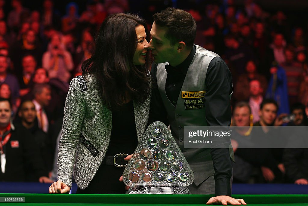 Mark Selby of England celebrates with his wife Vikki Layton and The Masters Trophy after winning The Masters Final between Mark Selby of England and Neil Robertson of Australia at Alexandra Palace on January 20, 2013 in London, England.