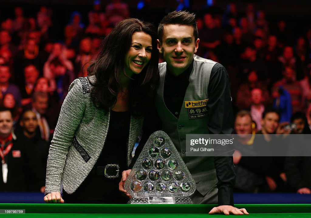 <a gi-track='captionPersonalityLinkClicked' href=/galleries/search?phrase=Mark+Selby&family=editorial&specificpeople=676444 ng-click='$event.stopPropagation()'>Mark Selby</a> of England celebrates with his wife Vikki Layton and The Masters Trophy after winning The Masters Final between <a gi-track='captionPersonalityLinkClicked' href=/galleries/search?phrase=Mark+Selby&family=editorial&specificpeople=676444 ng-click='$event.stopPropagation()'>Mark Selby</a> of England and Neil Robertson of Australia at Alexandra Palace on January 20, 2013 in London, England.
