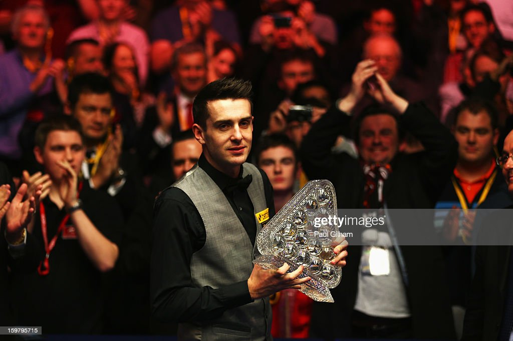 <a gi-track='captionPersonalityLinkClicked' href=/galleries/search?phrase=Mark+Selby&family=editorial&specificpeople=676444 ng-click='$event.stopPropagation()'>Mark Selby</a> of England celebrates with The Masters Trophy after winning The Masters Final between <a gi-track='captionPersonalityLinkClicked' href=/galleries/search?phrase=Mark+Selby&family=editorial&specificpeople=676444 ng-click='$event.stopPropagation()'>Mark Selby</a> of England and Neil Robertson of Australia at Alexandra Palace on January 20, 2013 in London, England.