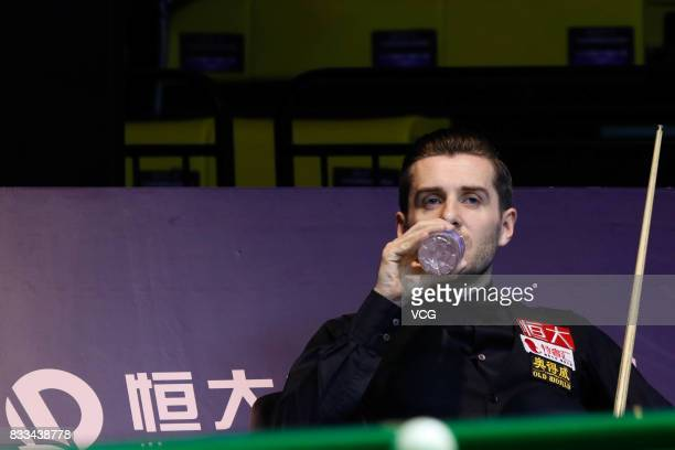 Mark Selby of England drinks water during his first round match against Noppon Saengkham of Thailand on day two of Evergrande 2017 World Snooker...