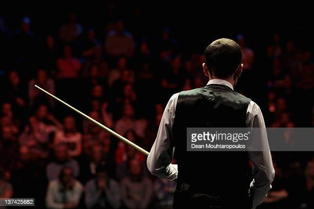 Mark Selby of England gets ready to play a shot during his Quater Final match with Shaun Murphy of England during day six of The Masters at Alexandra...