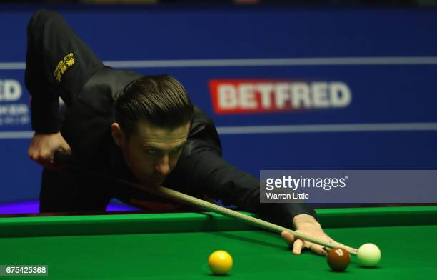 Mark Selby of England in action against John Higgins of Scotland in the final of the World Snooker Championship on day seventeen at Crucible Theatre...