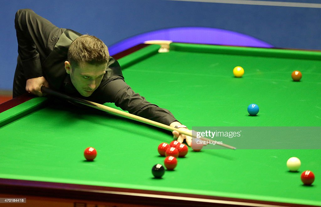 Mark Selby of England in action against Kurt Maflin of Norway during day one of the Betfred World Snooker Championship at Crucible Theatre on April...