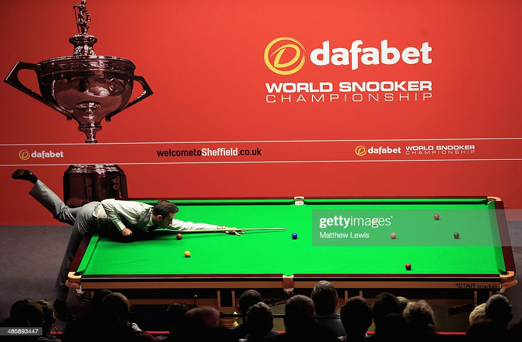 <a gi-track='captionPersonalityLinkClicked' href=/galleries/search?phrase=Mark+Selby&family=editorial&specificpeople=676444 ng-click='$event.stopPropagation()'>Mark Selby</a> of England in action against Michael White of Wales during day four of the The Dafabet World Snooker Championship at Crucible Theatre on April 21, 2014 in Sheffield, England.