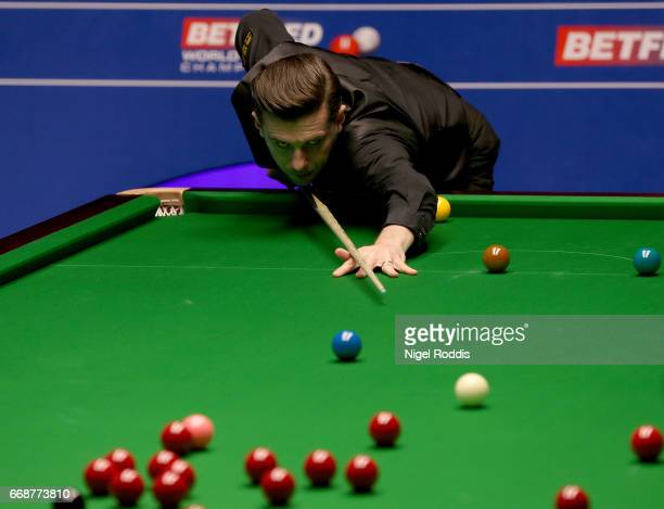 Mark Selby of England in action during his first round match against Fergal O'Brien of Ireland on day one of the World Championship Snooker at the...