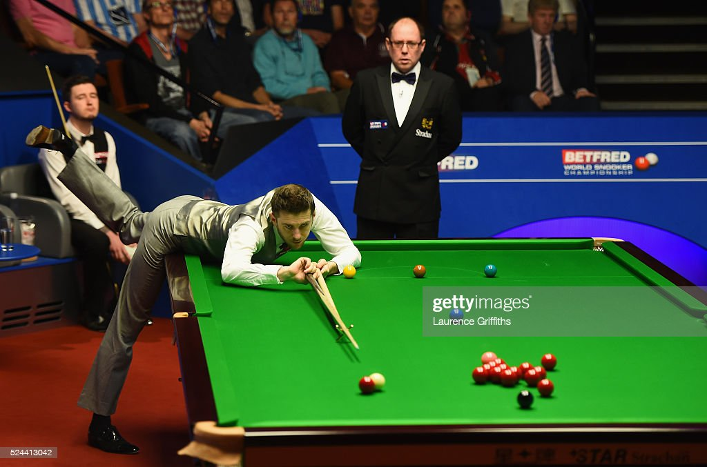 <a gi-track='captionPersonalityLinkClicked' href=/galleries/search?phrase=Mark+Selby&family=editorial&specificpeople=676444 ng-click='$event.stopPropagation()'>Mark Selby</a> of England in action during his quarter final match against <a gi-track='captionPersonalityLinkClicked' href=/galleries/search?phrase=Kyren+Wilson&family=editorial&specificpeople=11378566 ng-click='$event.stopPropagation()'>Kyren Wilson</a> of England on day eleven of the World Championship Snooker at Crucible Theatre on April 26, 2016 in Sheffield, England.