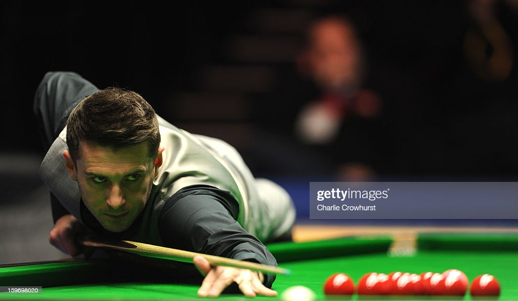 <a gi-track='captionPersonalityLinkClicked' href=/galleries/search?phrase=Mark+Selby&family=editorial&specificpeople=676444 ng-click='$event.stopPropagation()'>Mark Selby</a> of England in action during his quarter-final match against Mark Williams of Wales at Alexandra Palace on January 18, 2013 in London England.