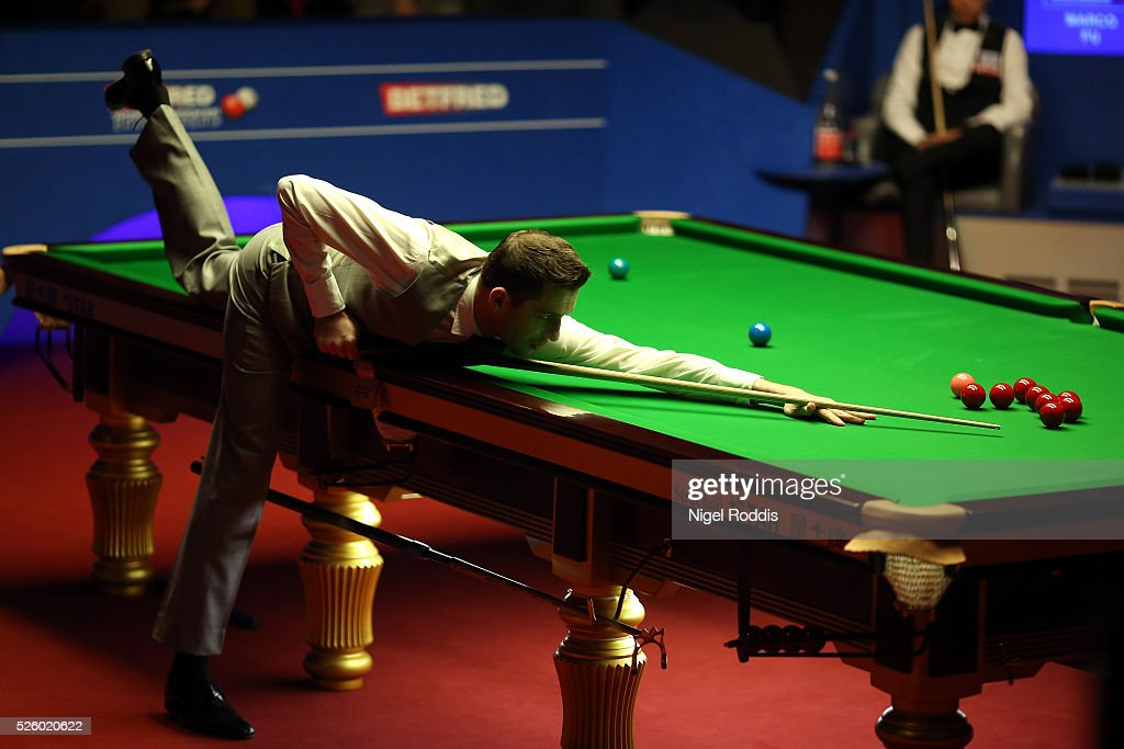 Mark Selby of England in action during his semi final match against Marco Fu of Hong Kong on day fourteen of the World Championship Snooker at Crucible Theatre on April 29, 2016 in Sheffield, England.