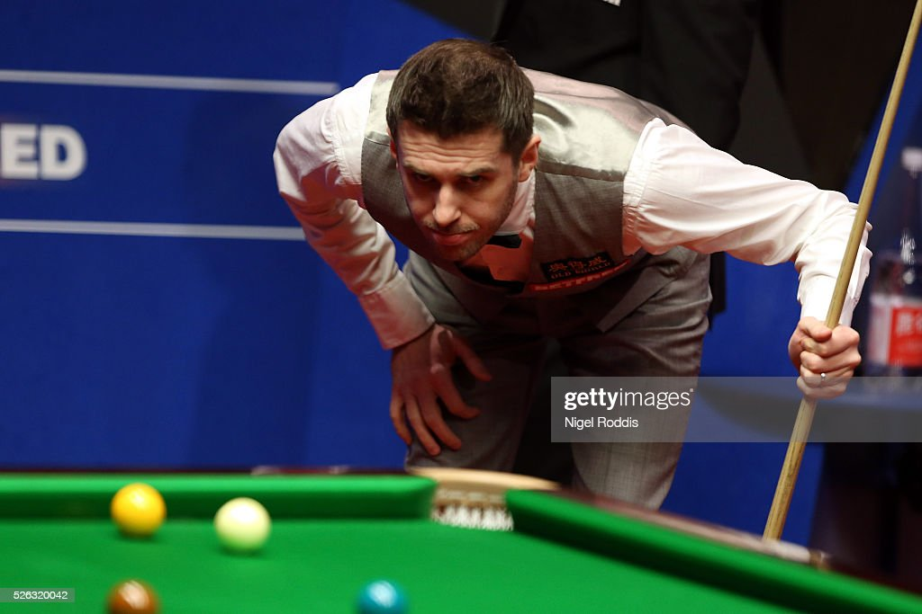 Mark Selby of England in action during his semi final match against Marco Fu of Hong Kong on day fifteen of the World Championship Snooker at...