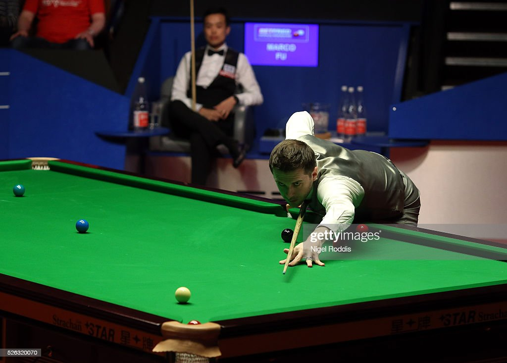 <a gi-track='captionPersonalityLinkClicked' href=/galleries/search?phrase=Mark+Selby&family=editorial&specificpeople=676444 ng-click='$event.stopPropagation()'>Mark Selby</a> of England in action during his semi final match against <a gi-track='captionPersonalityLinkClicked' href=/galleries/search?phrase=Marco+Fu&family=editorial&specificpeople=221154 ng-click='$event.stopPropagation()'>Marco Fu</a> of Hong Kong on day fifteen of the World Championship Snooker at Crucible Theatre on April 30, 2016 in Sheffield, England.