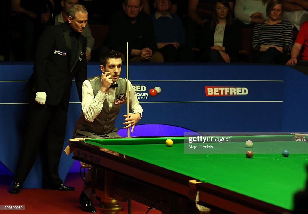 Mark Selby of England in action during his semi final match against Marco Fu of Hong Kong on day fifteen of the World Championship Snooker at Crucible Theatre on April 30, 2016 in Sheffield, England.