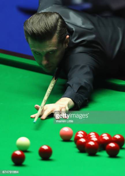 Mark Selby of England in action during his semifinal match against Ding Junhui of China on day fifteen of Betfred World Championship 2017 at Crucible...