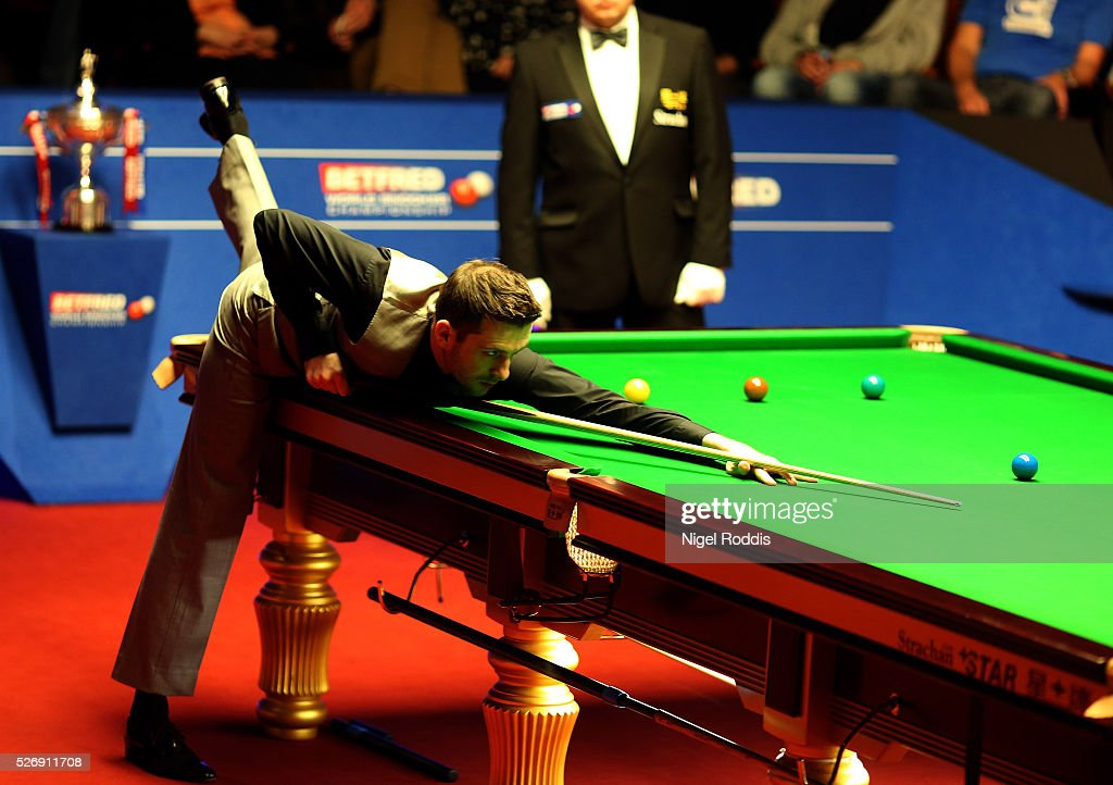 <a gi-track='captionPersonalityLinkClicked' href=/galleries/search?phrase=Mark+Selby&family=editorial&specificpeople=676444 ng-click='$event.stopPropagation()'>Mark Selby</a> of England in action during the final against <a gi-track='captionPersonalityLinkClicked' href=/galleries/search?phrase=Ding+Junhui&family=editorial&specificpeople=214712 ng-click='$event.stopPropagation()'>Ding Junhui</a> of China on day sixteen of the World Championship Snooker at Crucible Theatre on May 01, 2016 in Sheffield, England.