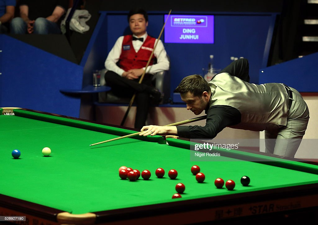 Mark Selby of England in action during the final against Ding Junhui of China on day sixteen of the World Championship Snooker at Crucible Theatre on May 01, 2016 in Sheffield, England.