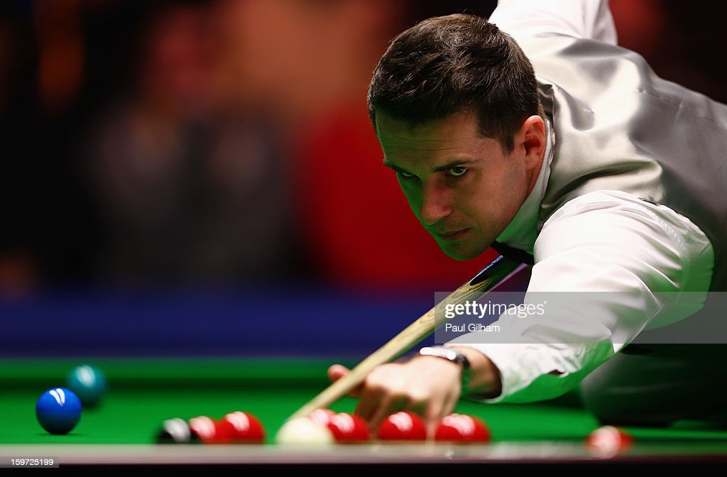 <a gi-track='captionPersonalityLinkClicked' href=/galleries/search?phrase=Mark+Selby&family=editorial&specificpeople=676444 ng-click='$event.stopPropagation()'>Mark Selby</a> of England in action during the semi-final match between Graeme Dott of Scotland and <a gi-track='captionPersonalityLinkClicked' href=/galleries/search?phrase=Mark+Selby&family=editorial&specificpeople=676444 ng-click='$event.stopPropagation()'>Mark Selby</a> of England at Alexandra Palace on January 19, 2013 in London, England.
