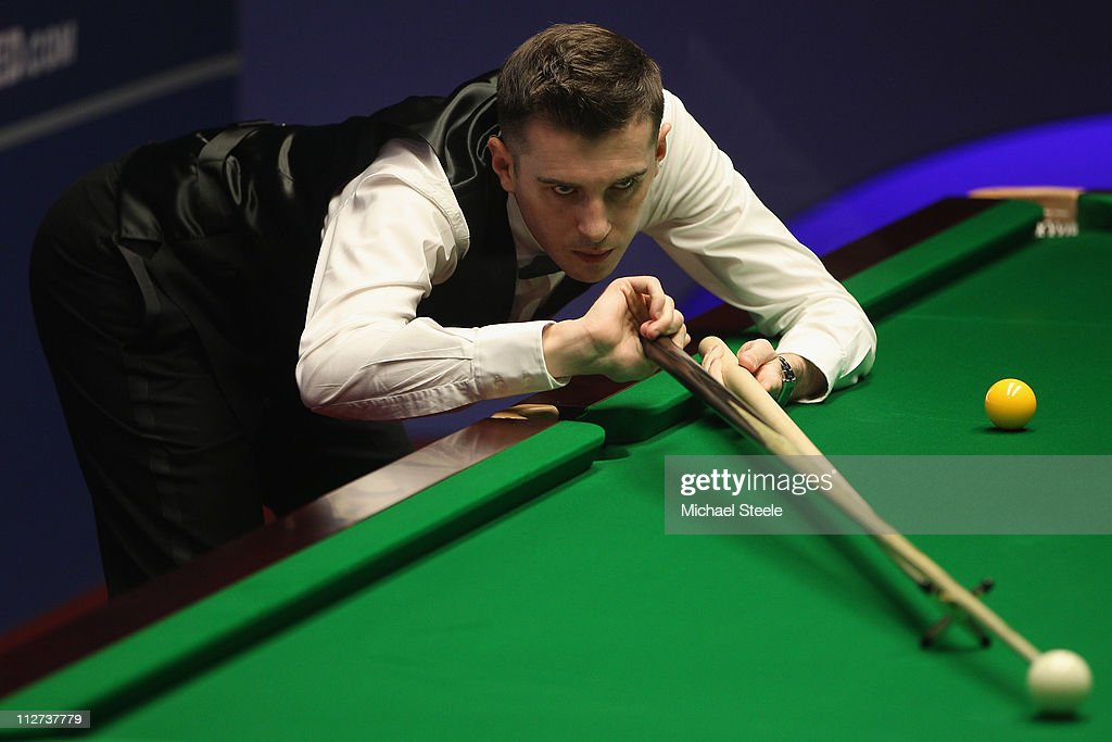 <a gi-track='captionPersonalityLinkClicked' href=/galleries/search?phrase=Mark+Selby&family=editorial&specificpeople=676444 ng-click='$event.stopPropagation()'>Mark Selby</a> of England in the round one game against Jimmy Robertson of England on day five of the Betfred.com World Snooker Championship at The Crucible Theatre on April 20, 2011 in Sheffield, England.