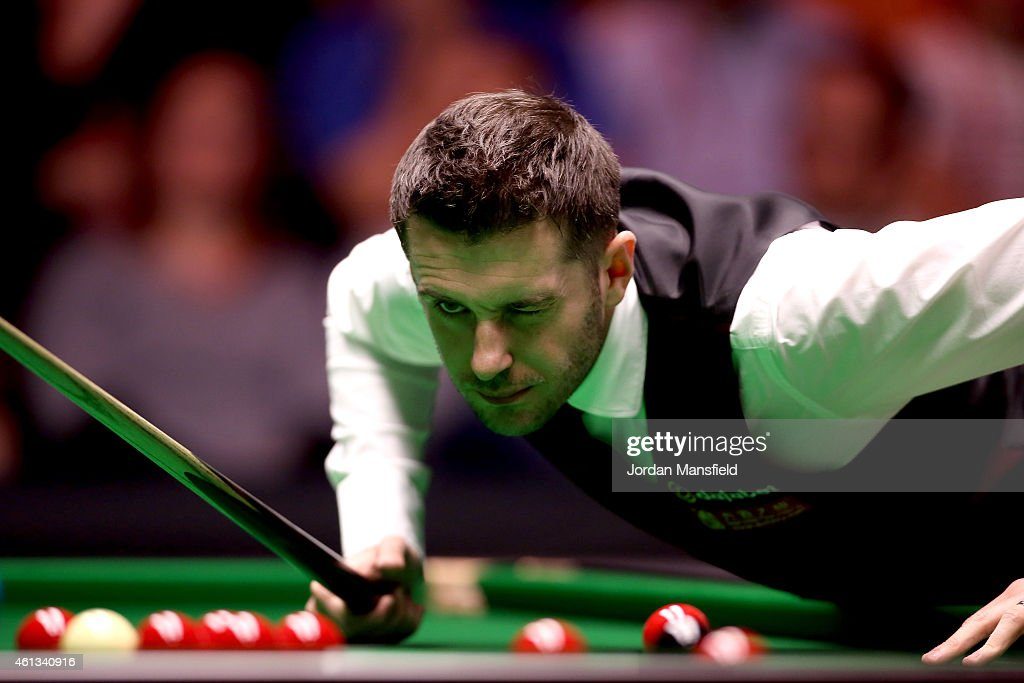 Mark Selby of England lines up a shot during his first round match against Shaun Murphy of England on day one of the 2015 Dafabet Masters at...