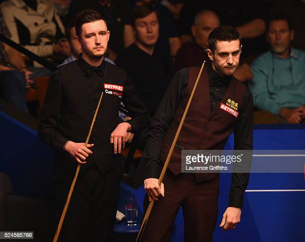 Mark Selby of England lines up a shot during his quarter final match against Kyren Wilson of England on day eleven of the World Championship Snooker...