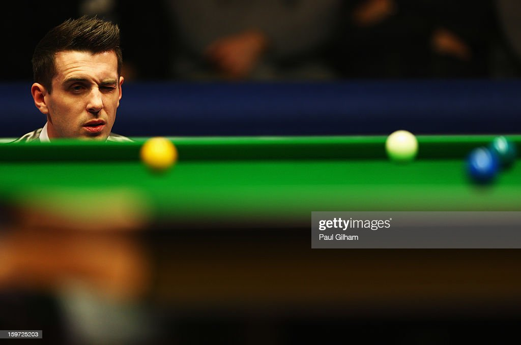 <a gi-track='captionPersonalityLinkClicked' href=/galleries/search?phrase=Mark+Selby&family=editorial&specificpeople=676444 ng-click='$event.stopPropagation()'>Mark Selby</a> of England lines up a shot during the semi-final match between Graeme Dott of Scotland and <a gi-track='captionPersonalityLinkClicked' href=/galleries/search?phrase=Mark+Selby&family=editorial&specificpeople=676444 ng-click='$event.stopPropagation()'>Mark Selby</a> of England at Alexandra Palace on January 19, 2013 in London, England.