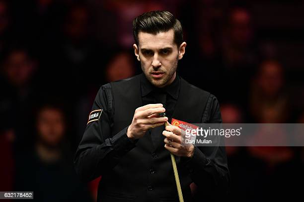 Mark Selby of England looks on during his quarter final match against Barry Hawkins of England on day six of the Dafabet Masters at Alexandra Palace...