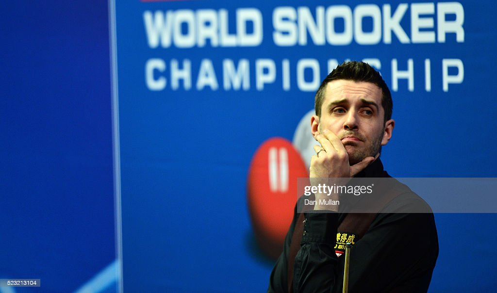 Mark Selby of England looks on during his second round match against Sam Baird of England on day seven of the World Snooker Championship at The...