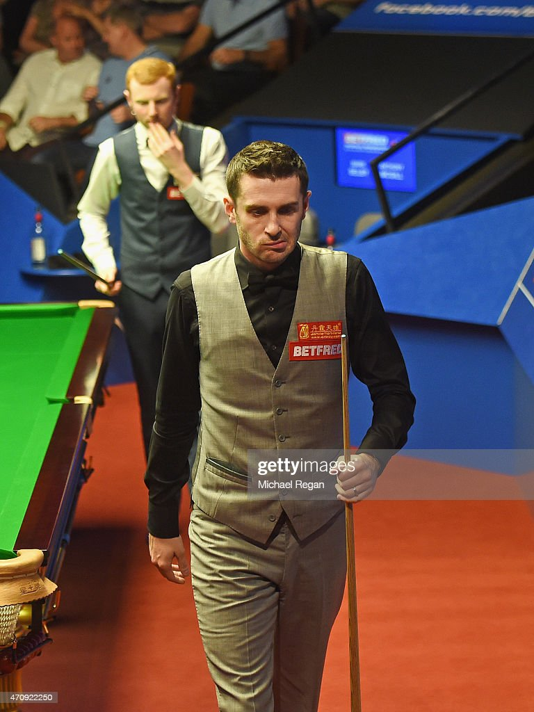 Mark Selby of England looks on in his match against Anthony McGill of Scotland during day seven of the 2015 Betfred World Snooker Championship at...