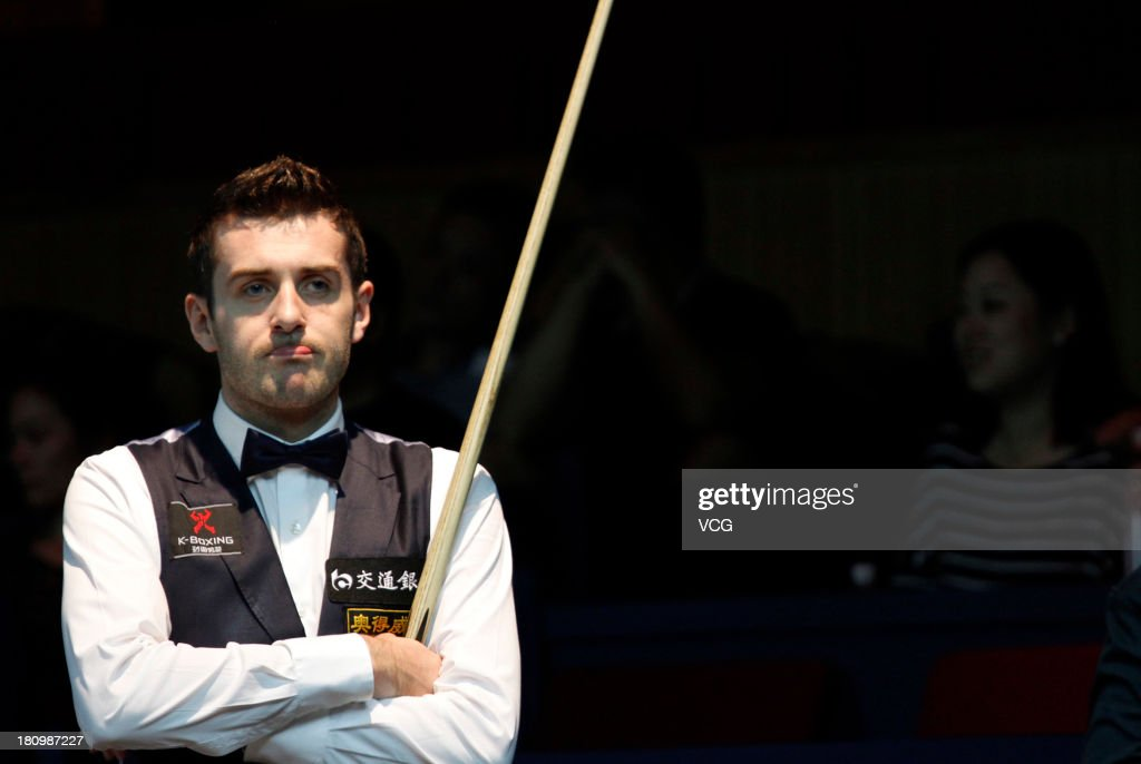 <a gi-track='captionPersonalityLinkClicked' href=/galleries/search?phrase=Mark+Selby&family=editorial&specificpeople=676444 ng-click='$event.stopPropagation()'>Mark Selby</a> of England looks on in the match against Lin Shuai of China on day three of the 2013 World Snooker Shanghai Master at Shanghai Grand Stage on September 18, 2013 in Shanghai, China.