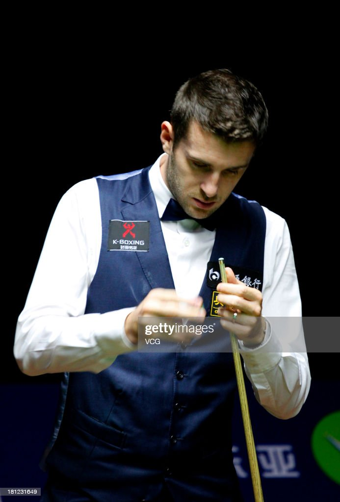 <a gi-track='captionPersonalityLinkClicked' href=/galleries/search?phrase=Mark+Selby&family=editorial&specificpeople=676444 ng-click='$event.stopPropagation()'>Mark Selby</a> of England looks on in the match against Robert Milkins of England on day four of the 2013 World Snooker Shanghai Master at Shanghai Grand Stage on September 19, 2013 in Shanghai, China.