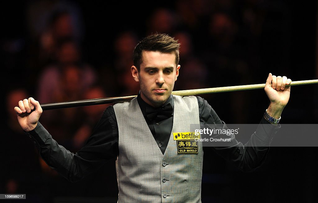 Mark Selby of England looks over the table during his quarter-final match against Mark Williams of Wales at Alexandra Palace on January 18, 2013 in London England.