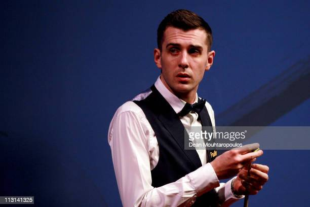 Mark Selby of England looks to play a shot in his round two game against Stephen Hendry of Scotland on day nine of the Betfredcom World Snooker...
