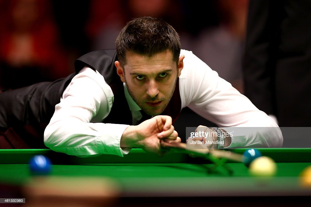 <a gi-track='captionPersonalityLinkClicked' href=/galleries/search?phrase=Mark+Selby&family=editorial&specificpeople=676444 ng-click='$event.stopPropagation()'>Mark Selby</a> of England plays a shot during his first round match against Shaun Murphy of England on day one of the 2015 Dafabet Masters at Alexandra Palace on January 11, 2015 in London, England.
