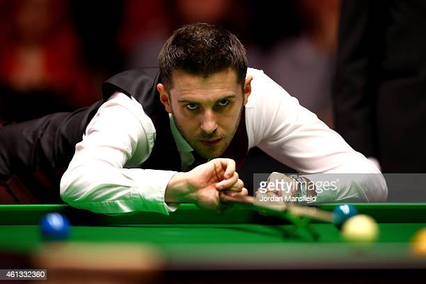 Mark Selby of England plays a shot during his first round match against Shaun Murphy of England on day one of the 2015 Dafabet Masters at Alexandra...