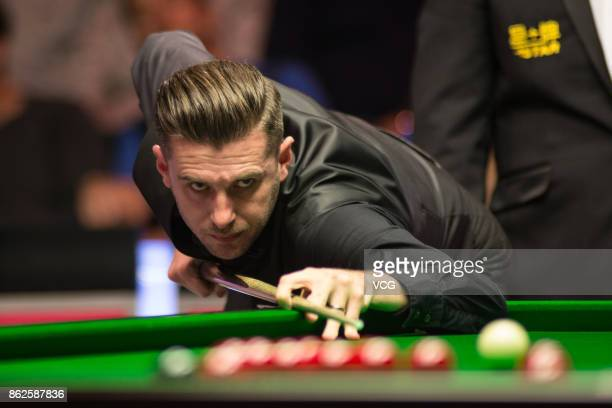Mark Selby of England plays a shot during his first round match against Scott Donaldson of Scotland on day two of 2017 Dafabet English Open at...