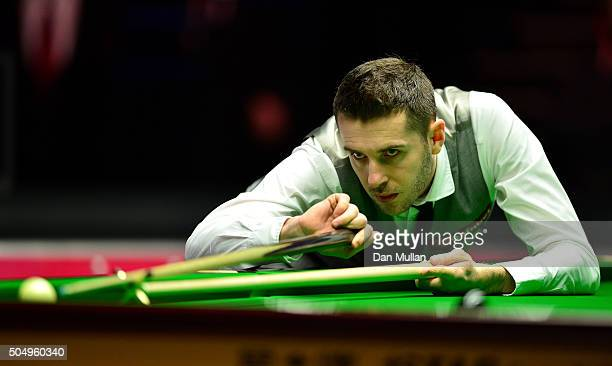 Mark Selby of England plays a shot during his quarter final match against Ronnie O'Sullivan on England during day five of The Dafabet Masters at...