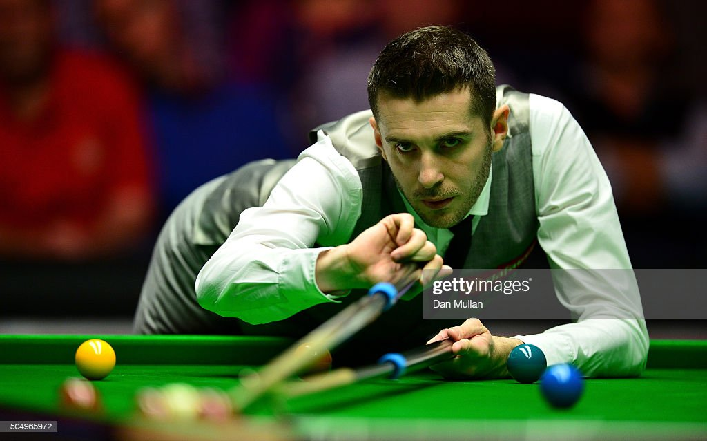 <a gi-track='captionPersonalityLinkClicked' href=/galleries/search?phrase=Mark+Selby&family=editorial&specificpeople=676444 ng-click='$event.stopPropagation()'>Mark Selby</a> of England plays a shot during his quarter final match against Ronnie O'Sullivan on England during day five of The Dafabet Masters at Alexandra Palace on January 14, 2016 in London, England.