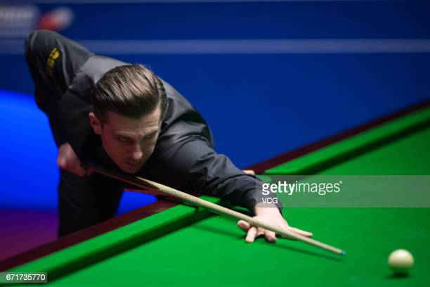 Mark Selby of England plays a shot during his second round match against Xiao Guodong of China on day eight of Betfred World Championship 2017 at...