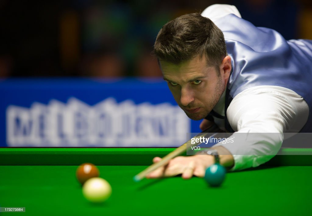 <a gi-track='captionPersonalityLinkClicked' href=/galleries/search?phrase=Mark+Selby&family=editorial&specificpeople=676444 ng-click='$event.stopPropagation()'>Mark Selby</a> of England plays a shot during the match against Zhang Anda of China on day three of the World Snooker Australia Open at the Bendigo Stadium on July 11, 2013 in Bendigo, Australia.