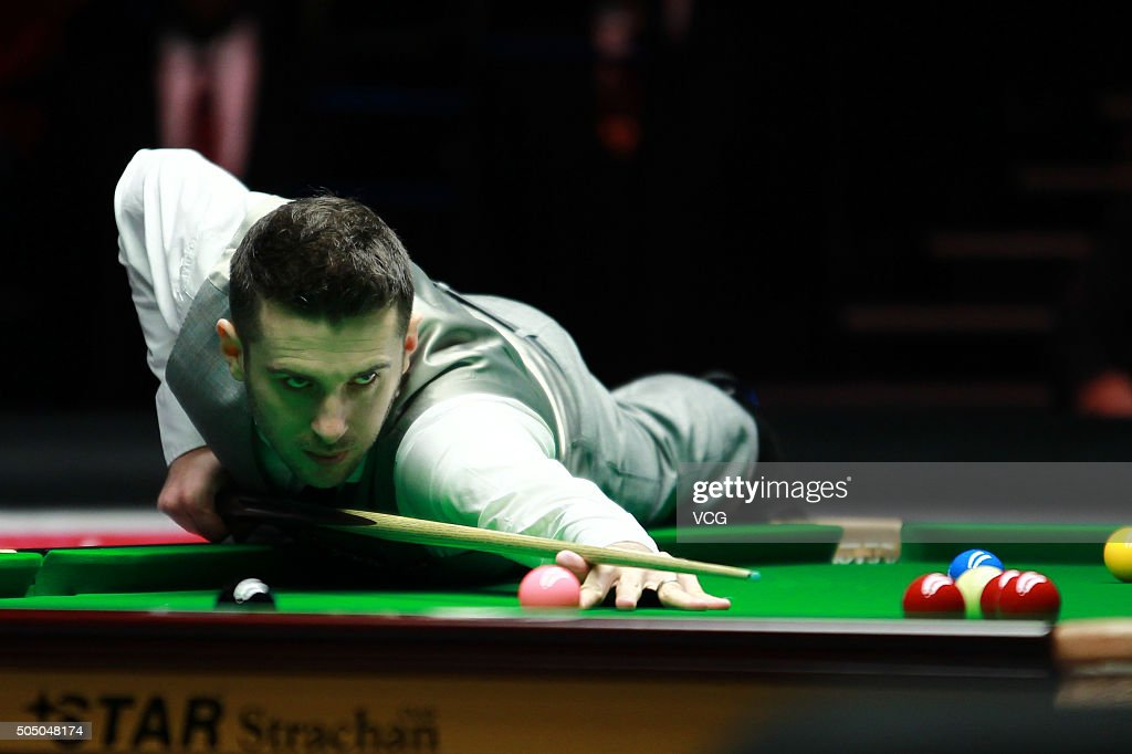 Mark Selby of England plays a shot in his quarterfinal match against Ronnie O'Sullivan of England during day five of The Dafabet Masters at Alexandra...
