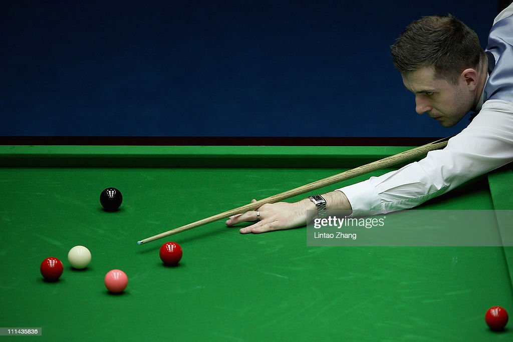 <a gi-track='captionPersonalityLinkClicked' href=/galleries/search?phrase=Mark+Selby&family=editorial&specificpeople=676444 ng-click='$event.stopPropagation()'>Mark Selby</a> of England plays a shot in semi-final match against Ding Junhui of China during the 2011 China Open at Beijing University Students Gymnasium on April 2, 2011 in Beijing, China.