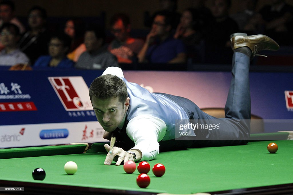 <a gi-track='captionPersonalityLinkClicked' href=/galleries/search?phrase=Mark+Selby&family=editorial&specificpeople=676444 ng-click='$event.stopPropagation()'>Mark Selby</a> of England plays a shot in the match against Lin Shuai of China on day three of the 2013 World Snooker Shanghai Master at Shanghai Grand Stage on September 18, 2013 in Shanghai, China.