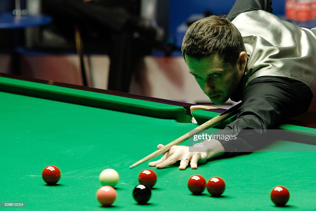 <a gi-track='captionPersonalityLinkClicked' href=/galleries/search?phrase=Mark+Selby&family=editorial&specificpeople=676444 ng-click='$event.stopPropagation()'>Mark Selby</a> of England plays a shot in the World Championship final against Ding Junhui of China on day sixteen of Betfred World Championship 2016 at The Crucible Theatre on May 1, 2016 in Sheffield, England.