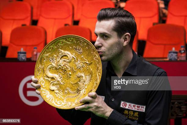 Mark Selby of England poses with his trophy after winning the final match against Mark Williams of Wales on day seven of 2017 China Open at Peking...