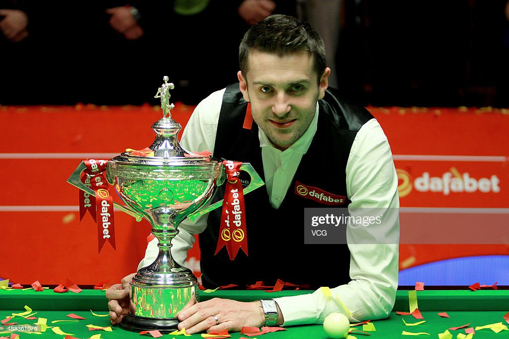 <a gi-track='captionPersonalityLinkClicked' href=/galleries/search?phrase=Mark+Selby&family=editorial&specificpeople=676444 ng-click='$event.stopPropagation()'>Mark Selby</a> of England poses with the trophy after winning The Dafabet World Snooker Championship final at Crucible Theatre on May 5, 2014 in Sheffield, England.