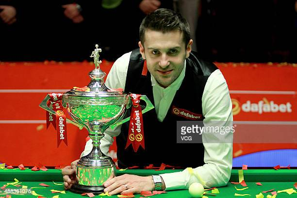 Mark Selby of England poses with the trophy after winning The Dafabet World Snooker Championship final at Crucible Theatre on May 5 2014 in Sheffield...