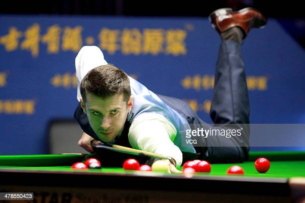 Mark Selby of England reacts against Liang Wenbo of China on day four of the 2014 Snooker Haikou World Open on March 13 2014 in Haikou Hainan...