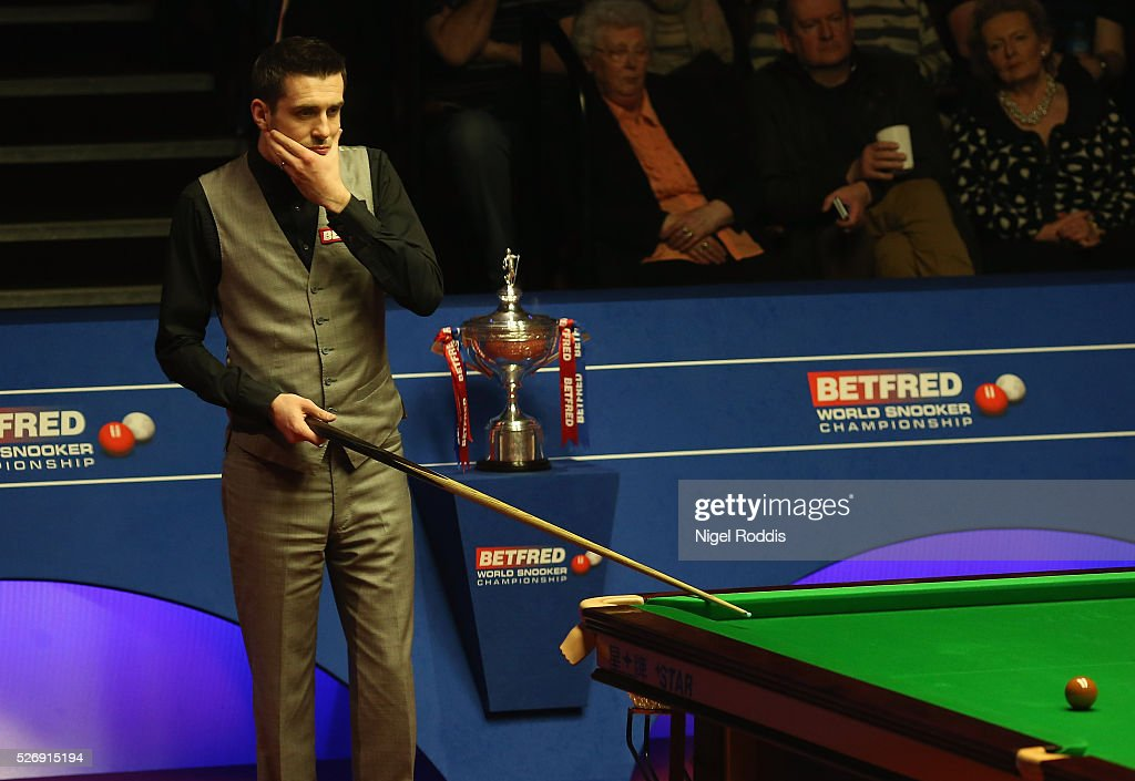 Mark Selby of England reacts during the final against Ding Junhui of China on day sixteen of the World Championship Snooker at Crucible Theatre on May 01, 2016 in Sheffield, England.