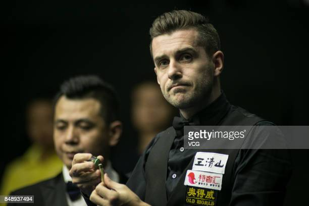 Mark Selby of England reacts during the qualifying match against Kritsanut Lertsattayathorn of Thailand on day one of the World Open 2017 at Yushan...